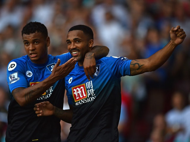 Bournemouth's Norwegian striker Joshua King and Bournemouth's English striker Callum Wilson (R) celebrate Wilson's early goal during the English Premier League football match between West Ham United and Bournemouth at The Boleyn Ground in Upton Park, East