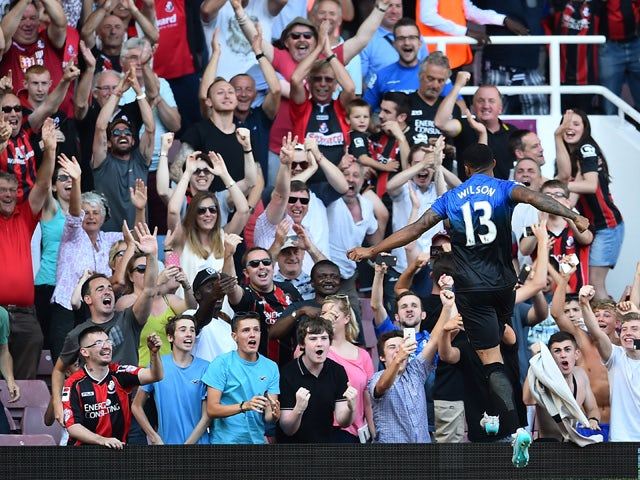 Bournemouth's English striker Callum Wilson celebrates scoring his third goal from the penalty spot during the English Premier League football match between West Ham United and Bournemouth at The Boleyn Ground in Upton Park, East London on August 22, 2015