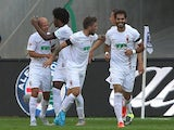 Augsburg's players celebrate Brazilian midfielder Caiuby scoring the 1-0 during the German first division Bundesliga football match Eintracht Frankfurt v FC Augsburg, on August 22, 2015
