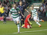 Leigh Griffiths of Celtic celebrates scoring his team's first goal during the UEFA Champions League Qualifying Round Play off First Leg match between Celtic and Malmo FF at Celtic Park on AUGUST 19, 2015