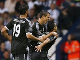Chelsea's Spanish midfielder Pedro (R) celebrates scoring the opening goal with Chelsea's Spanish defender Cesar Azpilicueta (2nd R) and Chelsea's Brazilian-born Spanish striker Diego Costa during the English Premier League football match between West Bro