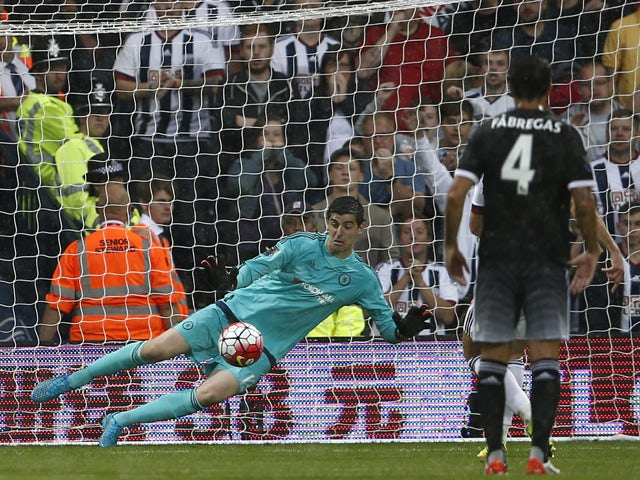 Chelsea's Belgian goalkeeper Thibaut Courtois dives to save a penalty taken by West Bromwich Albion's English-born Scottish midfielder James Morrison (not pictured) during the English Premier League football match between West Bromwich Albion and Chelsea