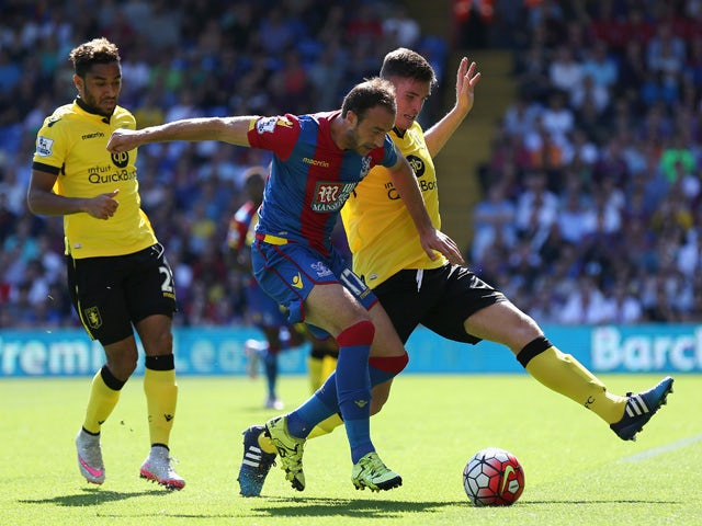 Glenn Murray of Crystal Palace and Ciaran Clark of Aston Villa compete for the ball during the Barclays Premier League match between Crystal Palace and Aston Villa at Selhurst Park on August 22, 2015