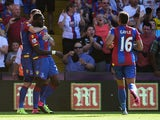 Bakary Sako of Crystal Palace celebrates scoring his team's second goal with his team mate Jordon Mutch (L) during the Barclays Premier League match between Crystal Palace and Aston Villa at Selhurst Park on August 22, 2015