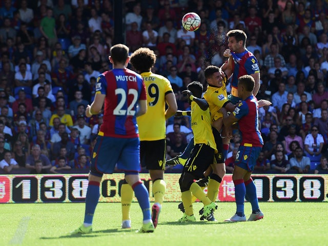 Scott Dann of Crystal Palace heads to score his team's first goal during the Barclays Premier League match between Crystal Palace and Aston Villa at Selhurst Park on August 22, 2015