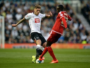 Jeff Hendrick of Derby County challenges Albert Adomah of Middlesbrough during the Sky Bet Championship match between Derby County and Middlesbrough at Pride Park Stadium on August 18, 2015