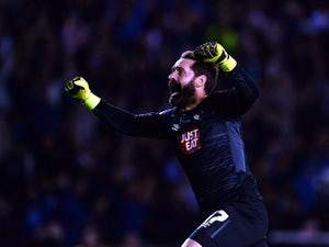 Scott Carson of Derby County reacts after teamate Johnny Russell scored during the Sky Bet Championship match between Derby County and Middlesbrough at Pride Park Stadium on August 18, 2015