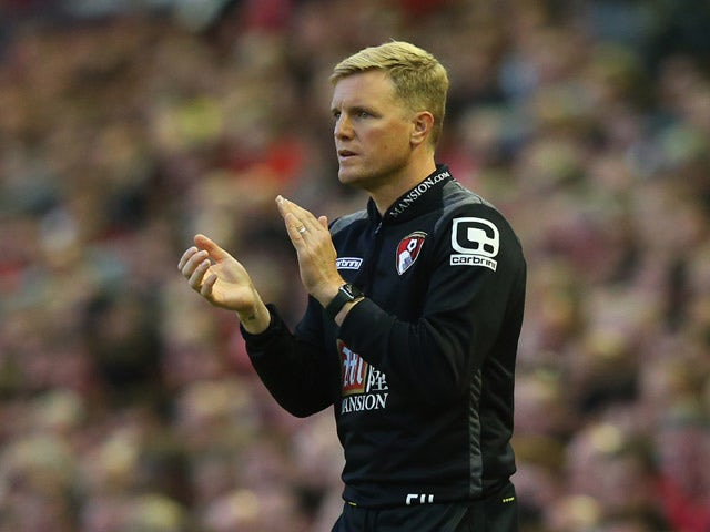 Eddie Howe manager of Bournemouth applauds during the Barclays Premier League match between Liverpool and A.F.C. Bournemouth at Anfield on August 17, 2015