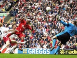 El-Hadji Diouf of Liverpool scores against Southampton on August 24, 2002