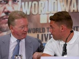 Frank Warren chats to Billy Joe Saunders during a press conference on August 17, 2015