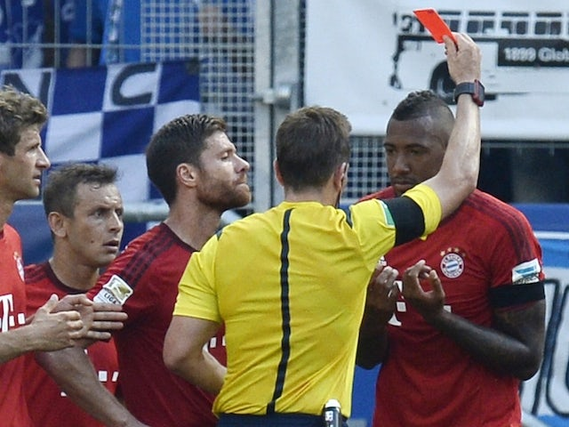 Referee Tobias Stieler shows the red card to Bayern Munich's defender Jerome Boateng during the German first division Bundesliga football match 1899 Hoffenheim v FC Bayern Munich, on August 22, 2015