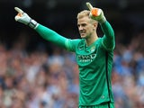 Man City keeper Joe Hart celebrates his side's second goal against Chelsea on August 16, 2015