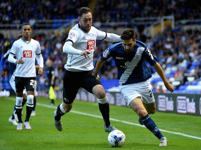Jon Toral of Birmingham is challenged by Richard Keogh of Derby during the Sky Bet Championship match between Birmingham City and Derby County at St Andrews (stadium) on August 21, 2015