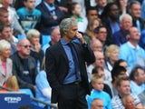 Chelsea boss Jose Mourinho attends to his nose during the match with Man City on August 16, 2015