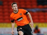 Keith Watson of Dundee United in action during the Scottish Premier League Match between Dundee United and St Mirren at Tannadice Park on December 30, 2012
