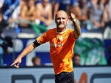 Darmstadt's defender Konstantin Rausch celebrates scoring the 1-0 during the German first division Bundesliga football match FC Schalke 04 v SV Darmstadt 98, on August 22, 2015