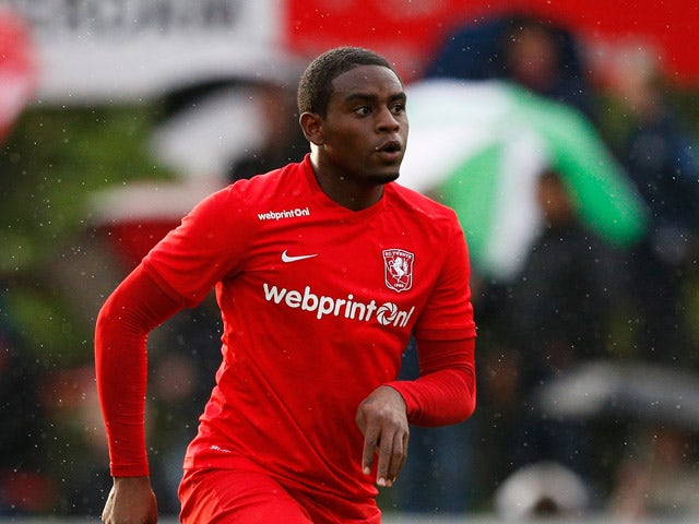 Kyle Ebecilio of Twente in action during the pre season friendly match between FC Twente and Olympiacos Piraeus held at Sportpark Veenoord on July 29, 2015