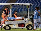 Lazio's defender from Netherlands Stefan de Vrij is carried out of the pitch after getting injured during the UEFA Champions League playoff football match between Lazio and Bayer Leverkusen, at Olympic stadium in Rome on August 18, 2015