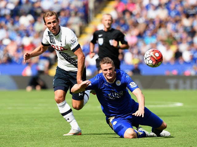 Harry Kane of Tottenham Hotspur and Robert Huth of Leicester City compete for the ball during the Barclays Premier League match between Leicester City and Tottenham Hotspur at The King Power Stadium on August 22, 2015