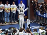 Mercedes AMG Petronas F1 Team's British driver Lewis Hamilton celebrates winning in the parc ferme at the Spa-Francorchamps circuit in Spa on August 23, 2015