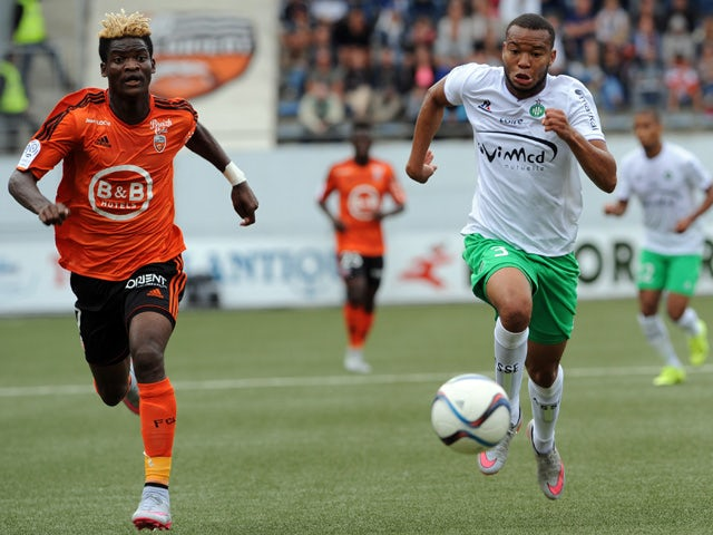 Lorient's forward Ibrahim Didier Ndong (L) vies with Saint-Etienne's French defender Pierre-Yves Polomat during the French L1 football match between Lorient and Saint-Etienne on August 23, 2015