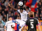 Tel Aviv's Nigerian midfielder Nosa Igiebor heads the ball between Basel's Swiss forward Breel Embolo (L) and Basel's Swiss defender Michael Lang during the UEFA Champions League playoff football match between FC Basel and Maccabi Tel Aviv at the St Jakob