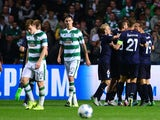 The Malmo players celebrate together after Jo Inge Berget goal early in the second half during the UEFA Champions League Qualifying play off first leg match, between at Celtic Park on August 19, 2015