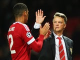 Louis van Gaal, manager of Manchester United celebrates victory with Chris Smalling after the UEFA Champions League Qualifying Round Play Off First Leg match between Manchester United and Club Brugge at Old Trafford on August 18, 2015