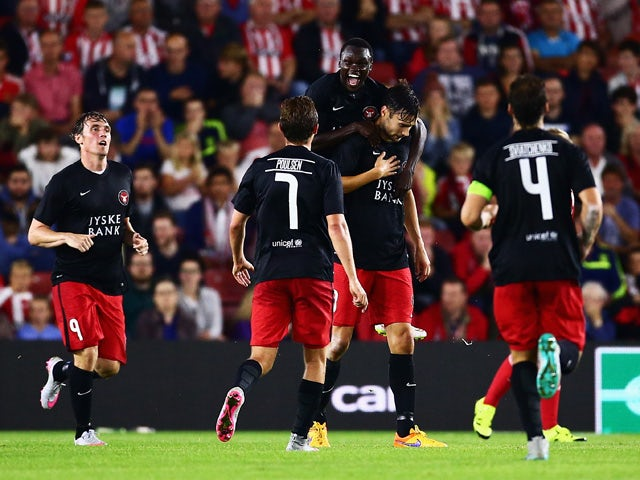 Pione Sisto of Midtjylland celebrates with goalscorer Tim Sparv after the opening goal during the UEFA Europa League Play Off Round 1st Leg match between Southampton and Midtjylland at St Mary's Stadium on August 20, 2015