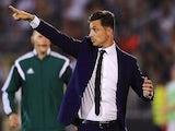 Coach Mirel Radoi gives instruction to the players during the UEFA Champions League Third Qualifying Round Second Leg match between FC Partizan Belgrade and FC Steaua Bucharest at FC Partizan stadium in Belgrade, Serbia on Wednesday, August 05, 2015