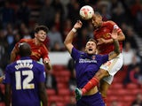 Dexter Blackstock of Nottingam Forest battles with Patrick Bauer of Charlton Athletic during the Sky Bet Championship match between Nottingham Forest and Charlton Athletic at City Ground on August 18, 2015