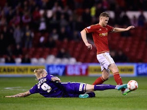 Matt Mills of Nottingam Forest battles with Simon Makienok of Charlton Athletic during the Sky Bet Championship match between Nottingham Forest and Charlton Athletic at City Ground on August 18, 2015