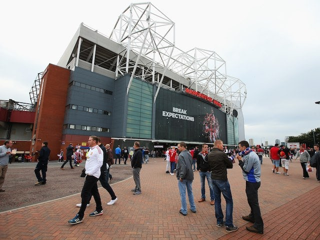Fans arrive at Old Trafford ahead of Man Utd's Champions League qualifier against Club Brugge on August 18, 2015