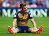 Lazy Olivier Giroud has a sit-down during Arsenal's win over Crystal Palace on August 16, 2015