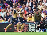 Olivier Giroud celebrates scoring Arsenal's first goal with Hector Bellerin on August 16, 2015