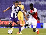 Toulouse's Italian-Argentinian midfielder Oscar Trejo vies with Monaco's French Midfielder Tiemoue Bakayoko during the French L1 football match between Toulouse and Monaco on August 22, 2015