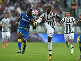 Paul Pogba (R) of Juventus FC is challenged by Emmanuel Badu of Udinese Calcio during the Serie A match between Juventus FC and Udinese Calcio at Juventus Arena on August 23, 2015