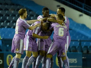 Danny Williams of Reading is congratulated after scoring the opening goal during the Sky Bet Championship match between Sheffield Wednesday and Reading at Hillsborough Stadium on August 19, 2015