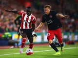 Sadio Mane of Southampton is challenged by Daniel Royer of Midtjylland during the UEFA Europa League Play Off Round 1st Leg match between Southampton and Midtjylland at St Mary's Stadium on August 20, 2015
