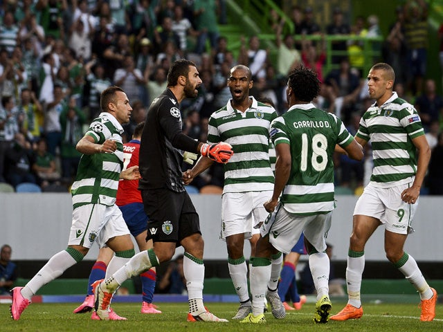 Sporting's goolkeeper Rui Patricio celebrates with teammates after stopping a penalty kick during the UEFA Champions League play off football match Sporting Portugal vs CSKA Moscou at the Jose Alvalade stadium in Lisbon on August 18, 2015