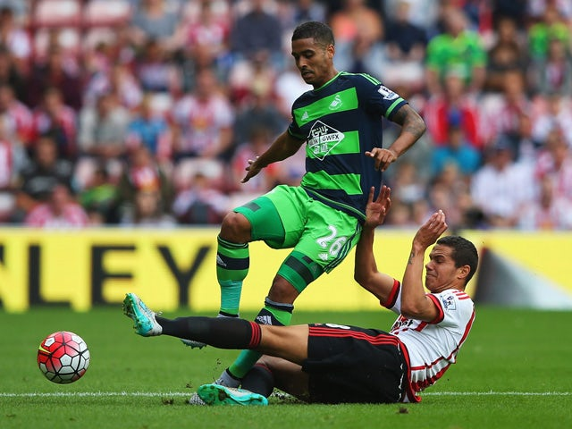 Kyle Naughton of Swansea City and Jack Rodwell of Sunderland compete for the ball during the Barclays Premier League match between Sunderland and Swansea City at the Stadium of Light on August 22, 2015