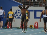 Jamaica's Usain Bolt (2L) reacts after making a false start in the final of the men's 100 metres at The International Association of Athletics Federations (IAAF) World Championships in Daegu on August 28, 2011