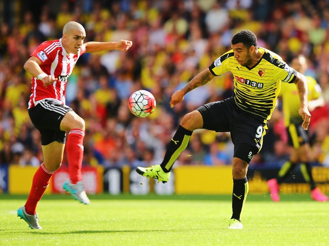 Troy Deeney of Watford is challenged by Oriol Romeu of Southampton during the Barclays Premier League match between Watford and Southampton at Vicarage Road on August 23, 2015