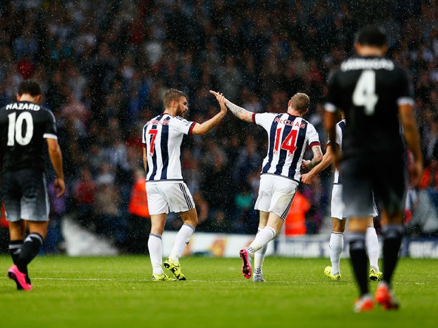 James Morrison (L) of West Bromwich Albion celebrates his goal with James McClean of West Bromwich Albion during the Barclays Premier League match between West Bromwich Albion and Chelsea at The Hawthorns on August 23, 2015