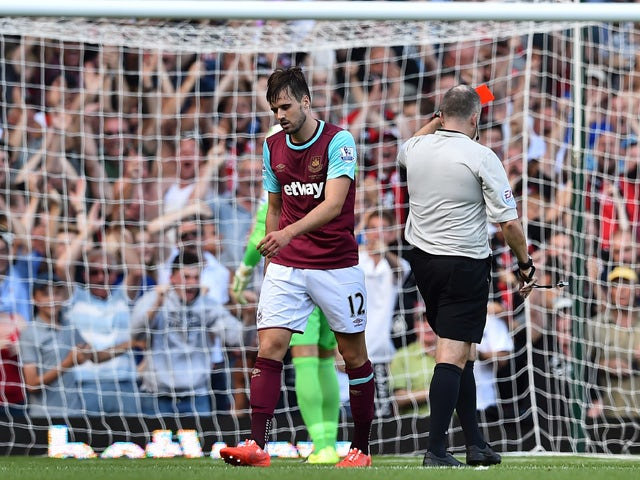 West Ham United's English midfielder Carl Jenkinson walks from the pitch after receiving a red card from referee Jon Moss during the English Premier League football match between West Ham United and Bournemouth at The Boleyn Ground in Upton Park, East Lon