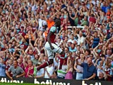 West Ham United's Senegalese midfielder Cheikhou Kouyate celebrates in front of supporters after scoring their second goal during the English Premier League football match between West Ham United and Bournemouth at The Boleyn Ground in Upton Park, East Lo