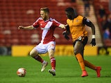 Adam Forshaw of Middlesbrough holds off Bakary Sako of Wolves during the Sky Bet Championship match between Middlesbrough and Wolverhampton Wanderers at Riverside Stadium on April 14, 2015