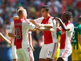 Anwar El Ghazi #21 of Ajax celebrates scoring his teams second goal of the game with team mates during the Dutch Eredivisie match between Ajax Amsterdam and ADO Den Hagg on August 30, 2015