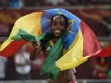 Ethiopia's Almaz Ayana celebrates winning the final of the women's 5000 metres athletics event at the 2015 IAAF World Championships at the 'Bird's Nest' National Stadium in Beijing on August 30, 2015