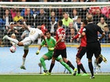 Andre Ayew of Swansea City scores past Sergio Romero of Manchester United during the Barclays Premier League match between Swansea City and Manchester United at Liberty Stadium on August 30, 2015
